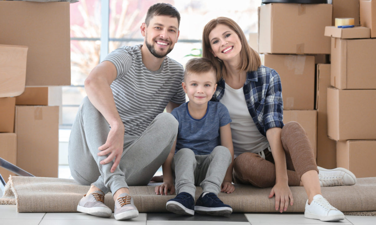 Young family moving into their first townhome aand unpacking together